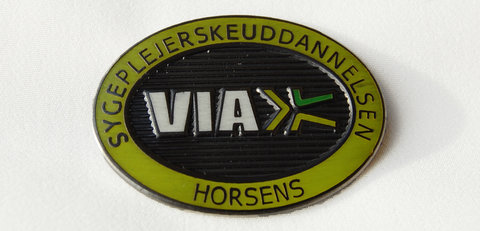 Emblem fra University College VIA, Horsens